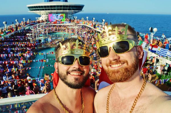 Two gay men taking a selfie on a cruise ship