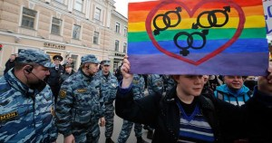 Activists protest Russia's anti-LGBT laws against Russian police