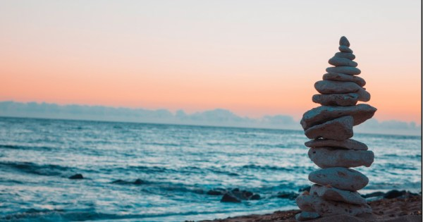 Stones stacked on a beach overlooking the sea
