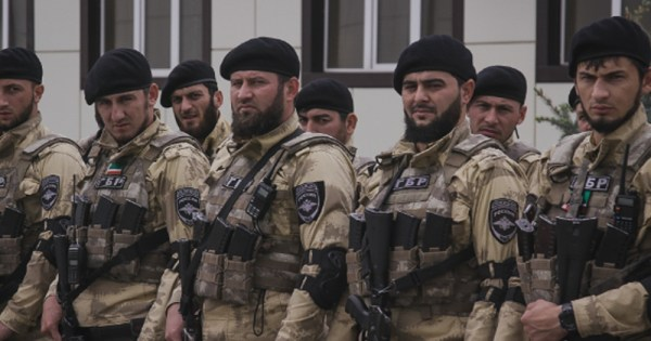Image of armed Chechen soldiers standing beside each other in uniform.