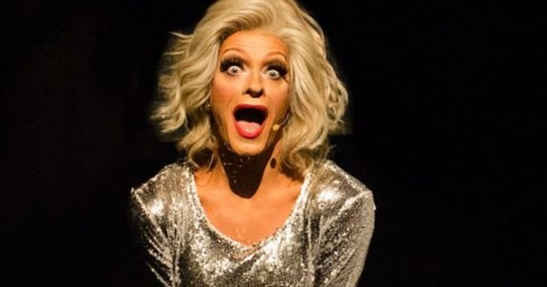 Panti Bliss in silver dress against black backdrop.