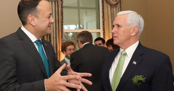 Leo Varadkar meeting Mike Pence in a busy room.
