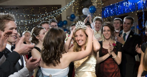A girl is crowned at her high school prom.