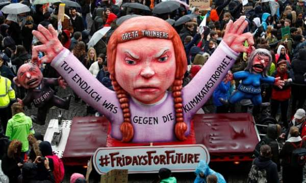 Climate action protest with giant float of Greta Thunberg