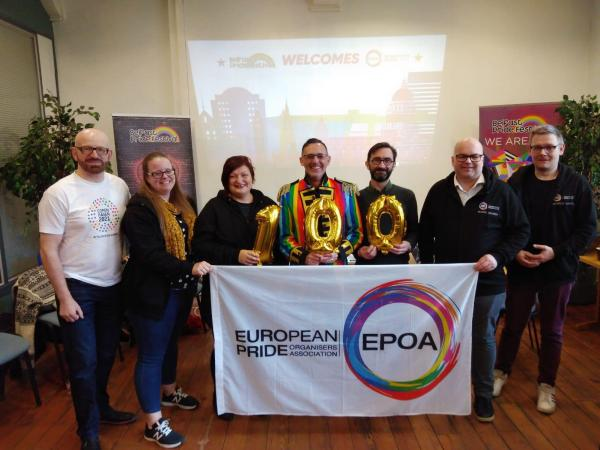 Dublin Pride organisers holding a banner while being inducted into the European Pride Organisers Association.