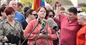 Friends and partner of Lyra McKee at a vigil