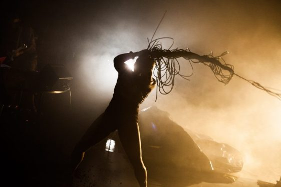 In a promo for Nightclubbing, a figure backlight by strong lights whips around a long plait seemingly made of wires