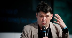 Graham Linehan, who claims he is not transphobic, speaks into a microphone