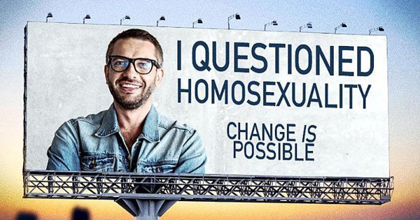 """Legal bans have not stopped forms of conversion therapy such as that promoted by this poster, reading """"I questioned homosexuality. Change is possible."""""""