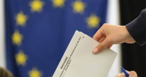 Submitting a vote against a background of the EU flag following the rise of the alt-right