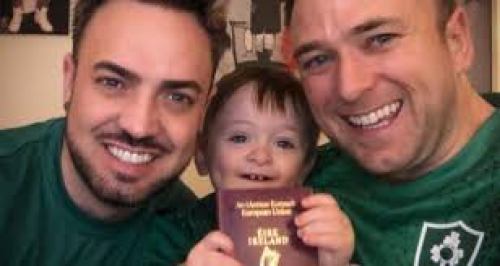 Jay and Aaron with their son holding his passport