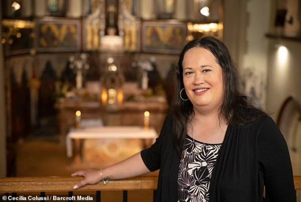 Ms. Cacace, former transgender catholic priest, stands in Church