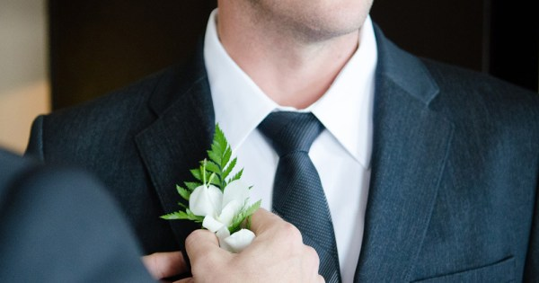 Campaigners hopeful of a January 2020 deadline for same-sex marriage in Northern Ireland Fixing the corsage on a man's suit in preparation for a wedding.