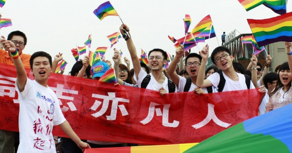 Chinese gay rights campaigners parading rainbow flags