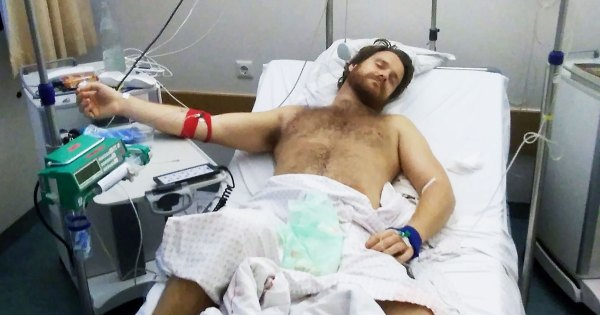 A man in a hospital bed with medical equipment after being admitted for complications due to the use of an erection enhancing drug