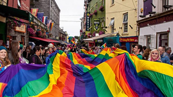 People holding a Pride flag at Galway Pride Parade