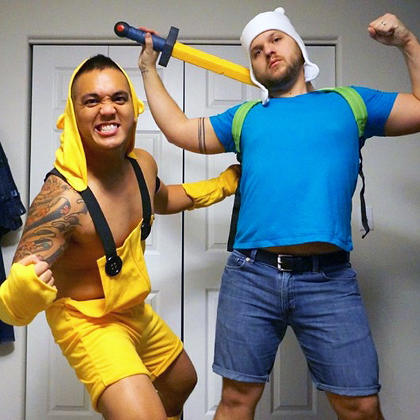 Two men dressed up in Jake and Finn Halloween costumes