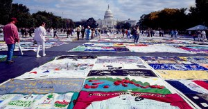 The AIDS Memorial Quilt laid out before the White House, stretching into the distance