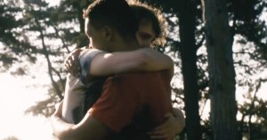 A screen grab from Brothers featuring two men hugging in a park