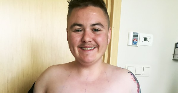 Close-up of young trans man smiling after his top surgery