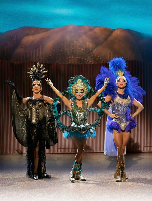 Three main performers wearing cabaret style outfits for a number in Priscilla Queen of the Desert