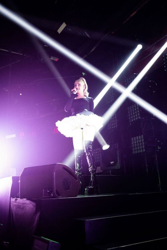 White beams of light shining on Kim Petras. Images by Babs Daly