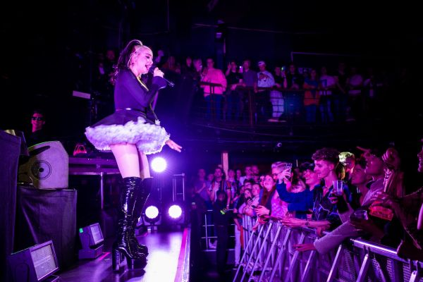 Kim Petras singing to the crowd. Images by Babs Daly