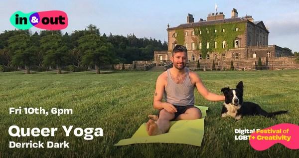 A bearded man in yoga gear sits beside a dog on a blanket in a field by a castle