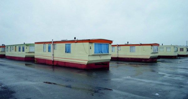 A bleak photo of a row of caravan dwellings at a direct provision centre