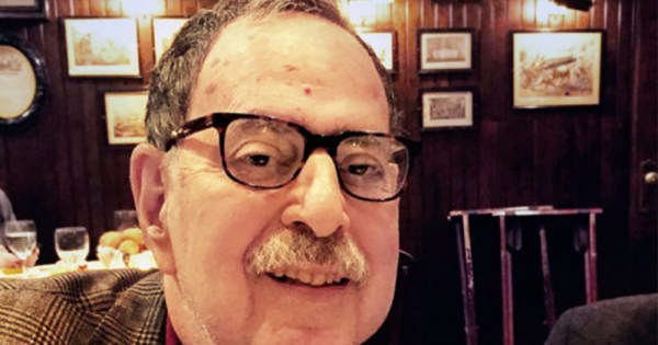 Dr Richard Friedman, an elderly man with glasses and a moustache, sitting in a restaurant
