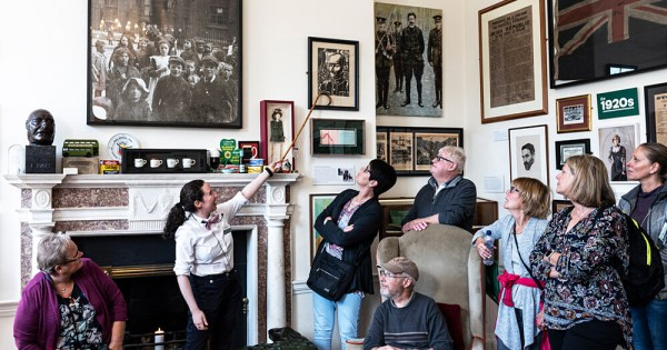 The Little Museum of Dublin with a tour guide pointing out a painting to a group of people