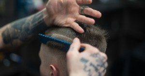 A man having his hair cut
