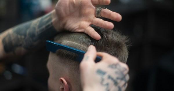 A man having his hair cut