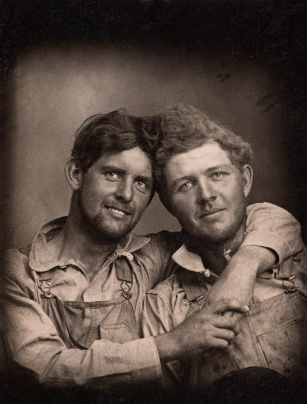 two men in overalls with their arms around each other, Loving a history of men in love through photographs