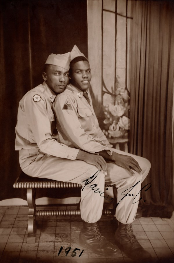 Two soldiers, one sitting on the others lap, Loving, a history of men in love through photographs