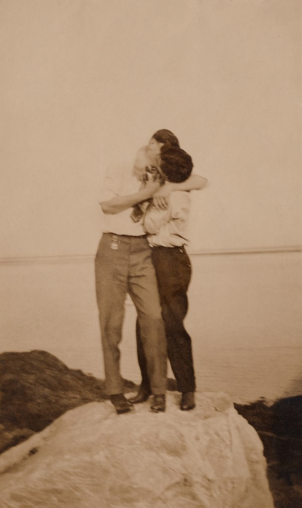 Two men kissing on top of a rock, Loving, a history of men in love through photographs