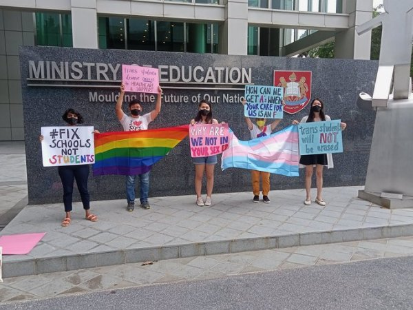 LGBTQ+ activists demonstrate outside Singapore's Ministry of Education