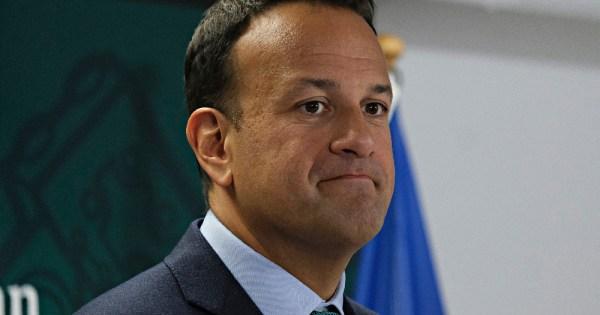 A male politician with a weird grin