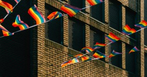ILGA rainbow Map 2021: picture of rainbow flags flying between buildings