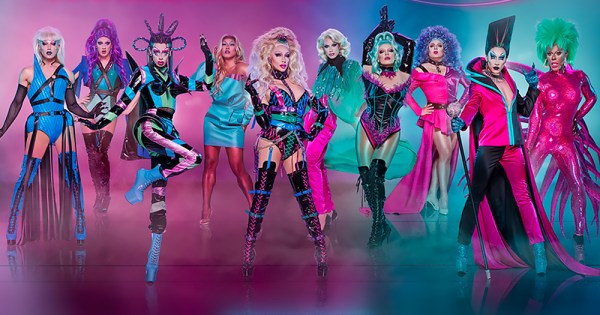 10 drag queens posing powerful against a multi coloured backdrop