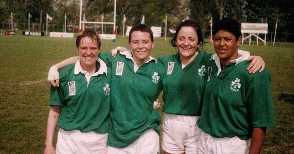 Four women in rugby gear embrace after a match