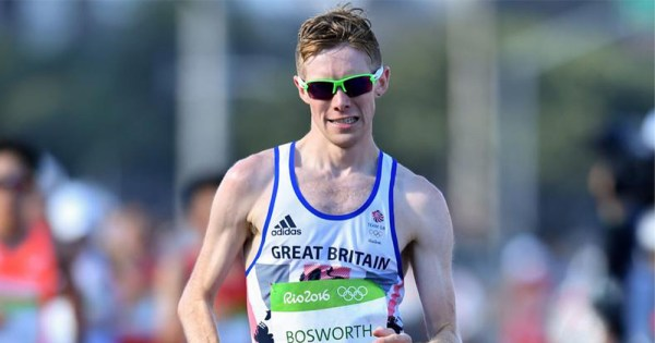A man wearing sun glasses taking part in a marathon