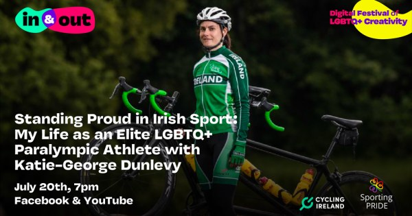 Katie George Dunleavy in cycling gear stands beside a bike