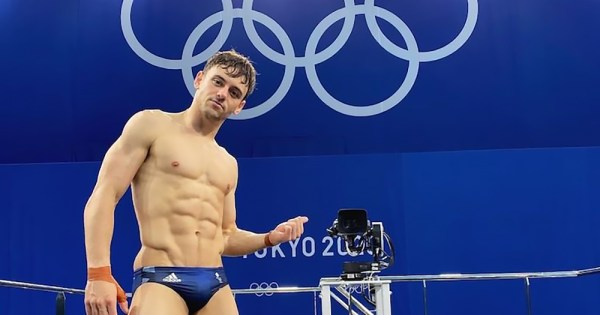 A well built young man wearing speedos on a diving board