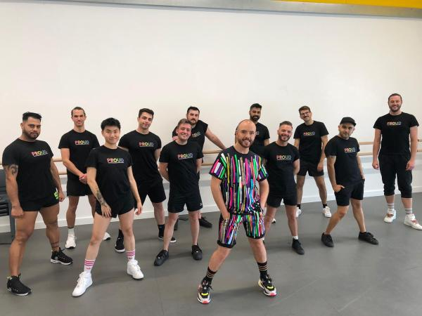 A group of dancers pose featured in Conleth Kane's Proud Remix video pose.
