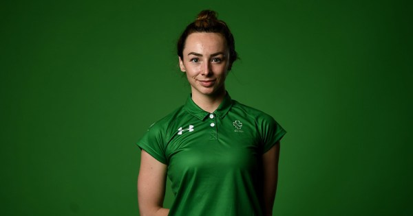 Irish Paralympian Ellen Keane is pictured wearing her Ireland jersey against a green background. Ellen won gold for Ireland at the Tokyo Paralympics.