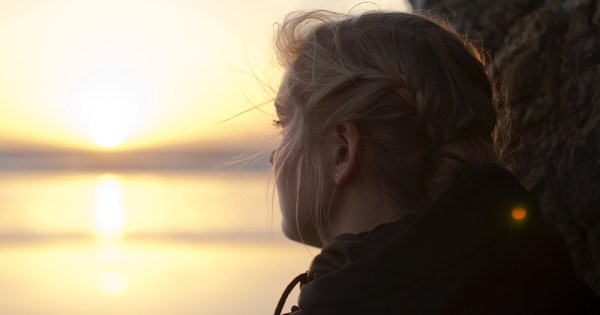 A woman looking at a sunset. In this piece, we explore the mental health services available for LGBTQ+ folks in Ireland