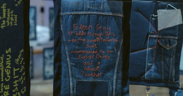 Words stitched into a hanging piece of denim fabric
