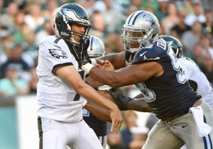 Sep 20, 2015; Philadelphia, PA, USA; Philadelphia Eagles quarterback Sam Bradford (7) is hit after throwing a pass by Dallas Cowboys defensive tackle Jack Crawford (58) during the first half at Lincoln Financial Field. Mandatory Credit: Eric Hartline-USA TODAY Sports ORG XMIT: USATSI-224506 ORIG FILE ID: 20150920_ggw_se7_100.JPG