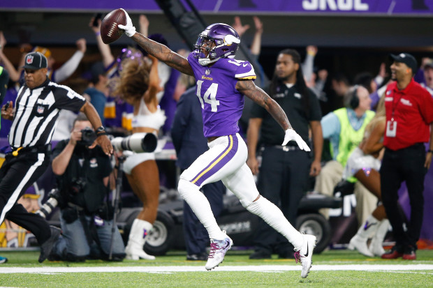 MINNEAPOLIS%2C+MN+-+JANUARY+14%3A++Stefon+Diggs+%2314+of+the+Minnesota+Vikings+scores+a+touchdown+as+time+expires+against+the+New+Orleans+Saints+during+the+second+half+of+the+NFC+Divisional+Playoff+game+at+U.S.+Bank+Stadium+on+January+14%2C+2018+in+Minneapolis%2C+Minnesota.++%28Photo+by+Jamie+Squire%2FGetty+Images%29